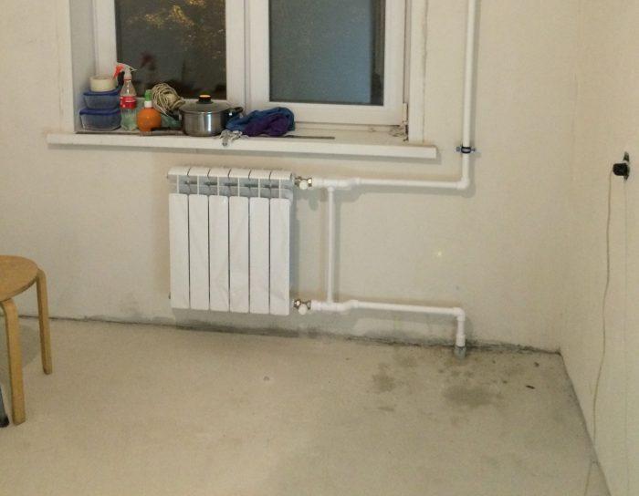 расположение радиатора на стене