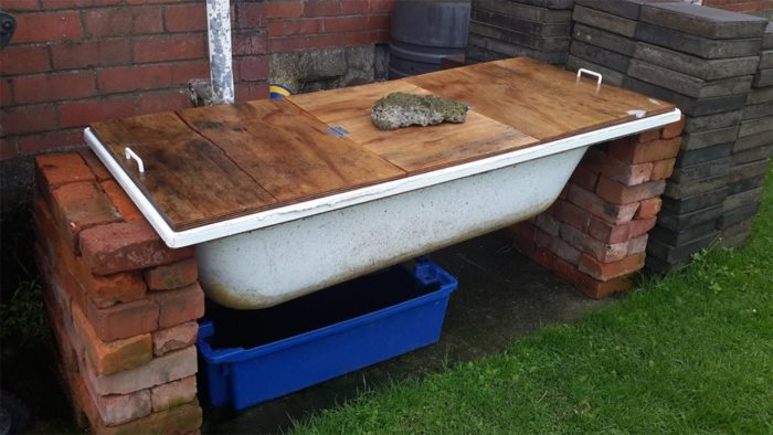 компостная яма из старой ванной